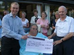 Tim presenting a cheque to the New Holehird charity