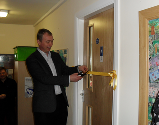 Tim opening a new classroom