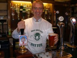 Tim Farron MP pulling a pint of Dent Brewery beer in the Strangers Bar