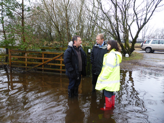 Tim with local residents near Levens after Storm Desmond in 2015