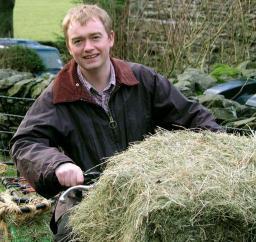 Tim on a quad bike on a hill farm