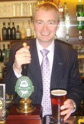 Tim pulls the first pint of Hawkshead bitter in the Stranger's Bar
