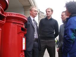 Tim Farron with local residents at a Post Office
