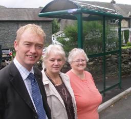 Tim with local residents at the modern bus shelter in Chapel Stitle