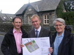 Tim Farron and Cllr Colin Davies view plans for new affordable housing in Hawkshead