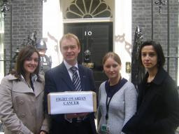 Tim Farron MP with cancer campaigners taking petitions to no. 10