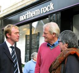 Tim speaking to local residents outside a bank
