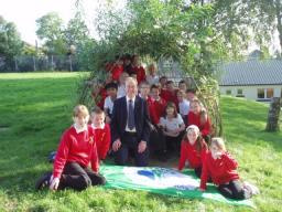 Tim with pupils from Grange Primary School and their 'green flag'