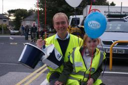 Tim Farron MP with his daughter Gracie at Torchlight