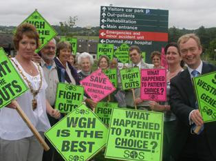 Tim and NHS SOS campaigners celebrate the cardiac unit victory