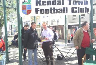 Kendal Town FC's Graham O'Callaghan, Tom Roe and Steve Dixon with Tim Farron MP (Kendal Town Football Club)