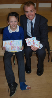 Tim Farron MP next to Alfie Pimblett (aged 10), the winner of Tim Farron's 2012 Christmas card competition.