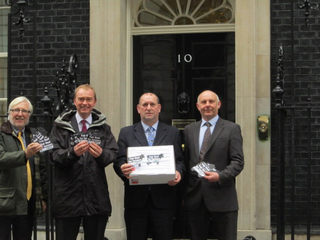 South Lakes MP Tim Farron, alongside the Leader of SLDC, Peter Thornton and NFU Secretary Derek Lomax, Mary Lomax and Michael Packham will took their petition demanding a fair deal for dairy farmers to Number 10 Downing Street