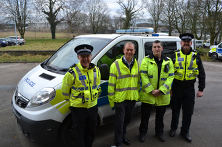 Tim with local officers